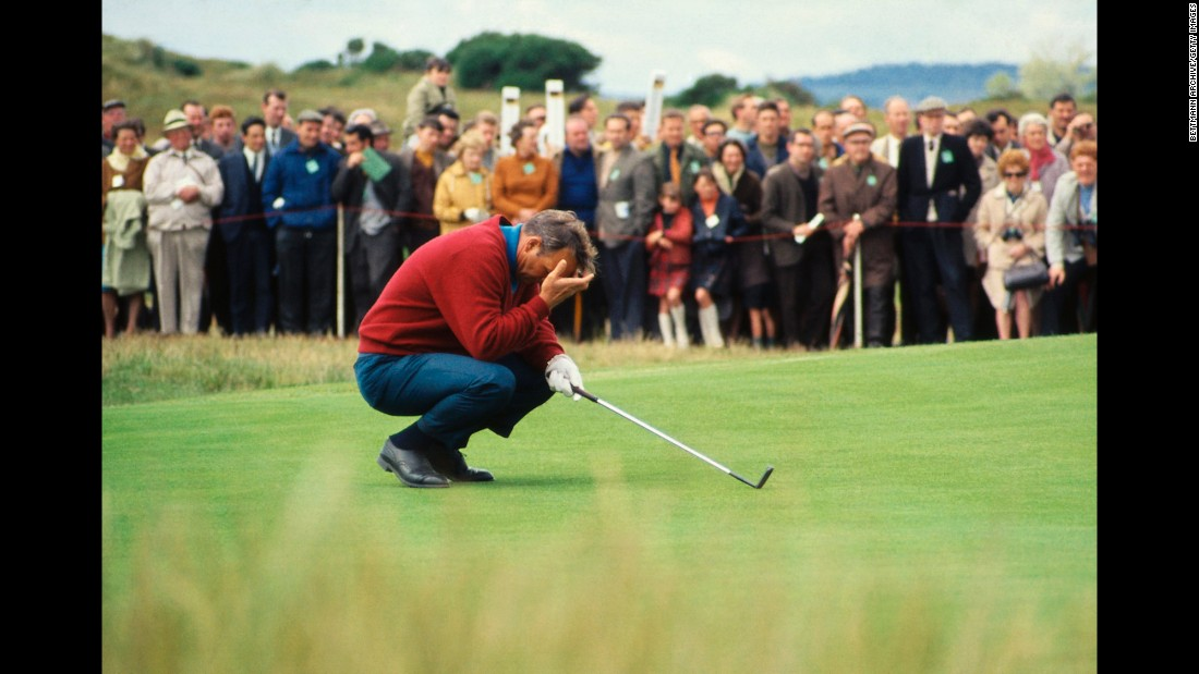 "It didn't always go ""the King's"" way. Here he is seen holding his head as he kneels on the third green during the 1968 British Open at Carnoustie."