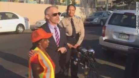 Los Angeles City Council Member Mitch O'Farrell recognizes crossing guard Adrian Young for saving an 8-year-old from being kidnapped.