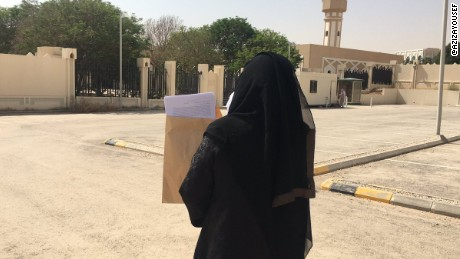 Activist Aziza Al-Yousef brings a petition calling for an end to the male guardianship system to the Royal Court in Riyadh on Monday