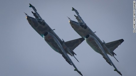This photo taken on September 24, 2016 shows Sukhoi SU-25 aircraft performing during the first Wonsan Friendship Air Festival in Wonsan. Just weeks after carrying out its fifth nuclear test, North Korea put on an unprecedented civilian and military air force display Saturday at the country's first ever public aviation show.  / AFP / Ed Jones        (Photo credit should read ED JONES/AFP/Getty Images)