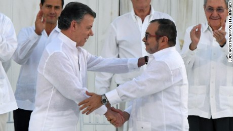 Colombian President Juan Manuel Santos  and the head of the FARC guerrilla Timoleon Jimenez shake hands during the signing of the historic peace agreement between the Colombian government and the Revolutionary Armed Forces of Colombia (FARC), in Cartagena, Colombia, on Monday, September 26.