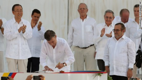 Colombia's President Juan Manuel Santos signs the peace agreement between Colombia's government and the FARC, to end over 50 years of conflict, in Cartagena, Colombia, Monday, September 26.