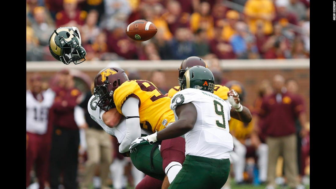 Colorado State quarterback Collin Hill loses his helmet as he's hit by Minnesota's Tai'yon Devers on Saturday, September 24.