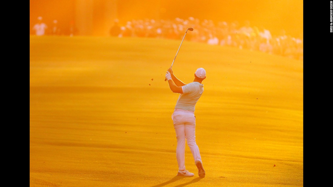 """Rory McIlroy hits an approach shot on the fourth playoff hole of the Tour Championship on Sunday, September 25. McIlroy birdied the hole to hold off Ryan Moore and <a href=""""http://www.cnn.com/2016/09/25/golf/fedexcup-mcilroy-moore-chappell-johnson/"""" target=""""_blank"""">win the FedEx Cup.</a>"""