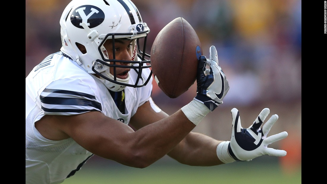 BYU wide receiver Moroni Laulu-Pututau focuses on the ball as he tries to make a catch against West Virginia on Saturday, September 24.