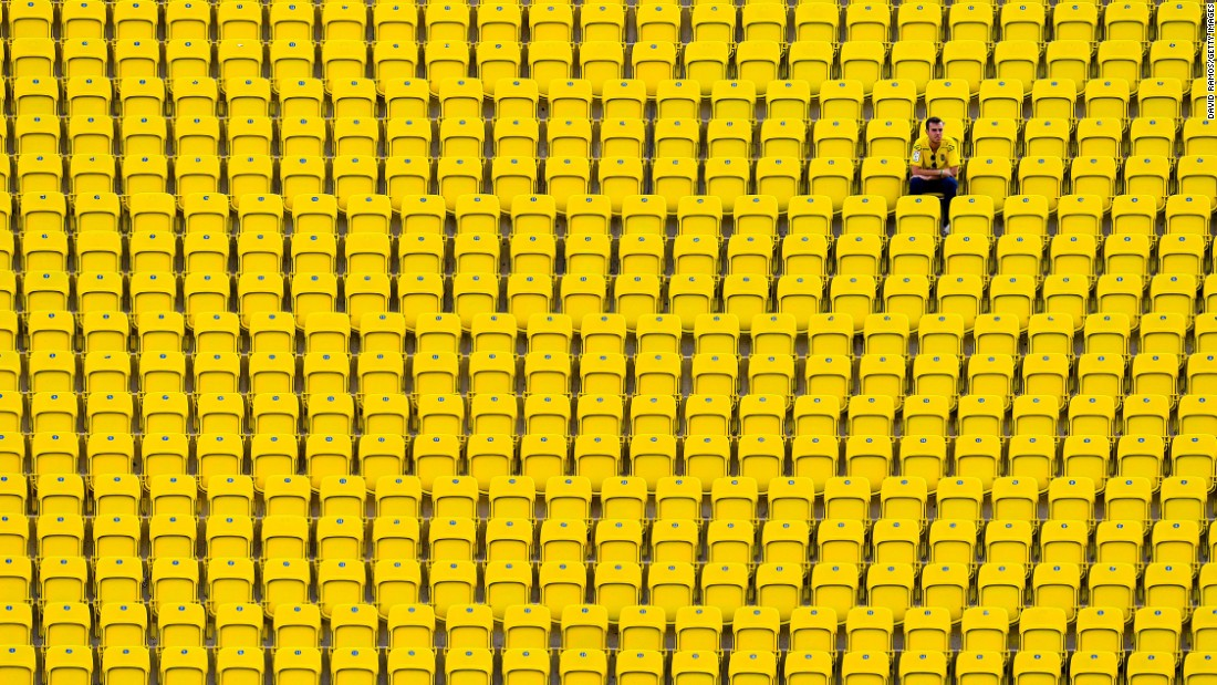 A supporter of the Spanish soccer club Las Palmas sits in the stands before a home match against Real Madrid on Saturday, September 24.