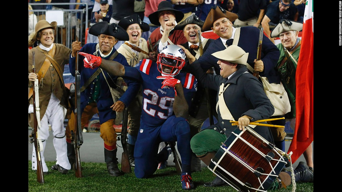 """LeGarrette Blount, a running back for the New England Patriots, celebrates with the """"End Zone Militia"""" after scoring a touchdown against Houston on Thursday, September 22. Blount had two touchdowns in the game, which the Patriots won 27-0."""