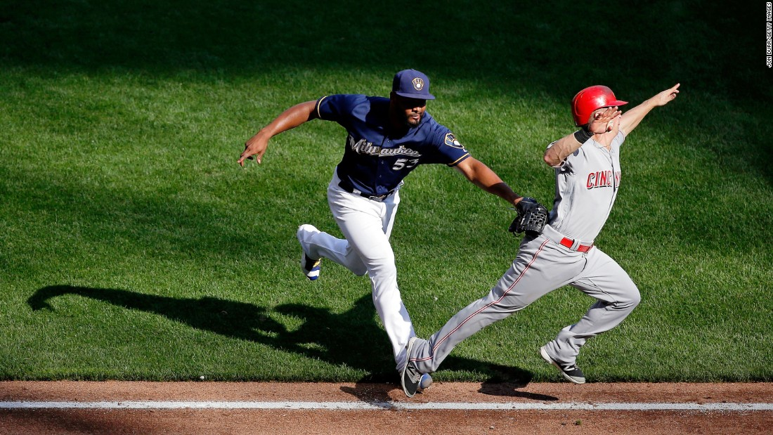 Milwaukee's Jhan Marinez tags out Cincinnati's Tony Renda during a Major League Baseball game in Milwaukee on Sunday, September 25.