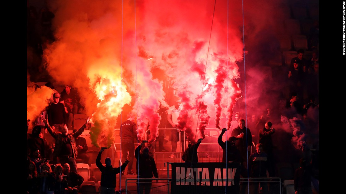 Flares are lit by Djurgardens fans during a Swedish soccer match in Stockholm on Wednesday, September 21.