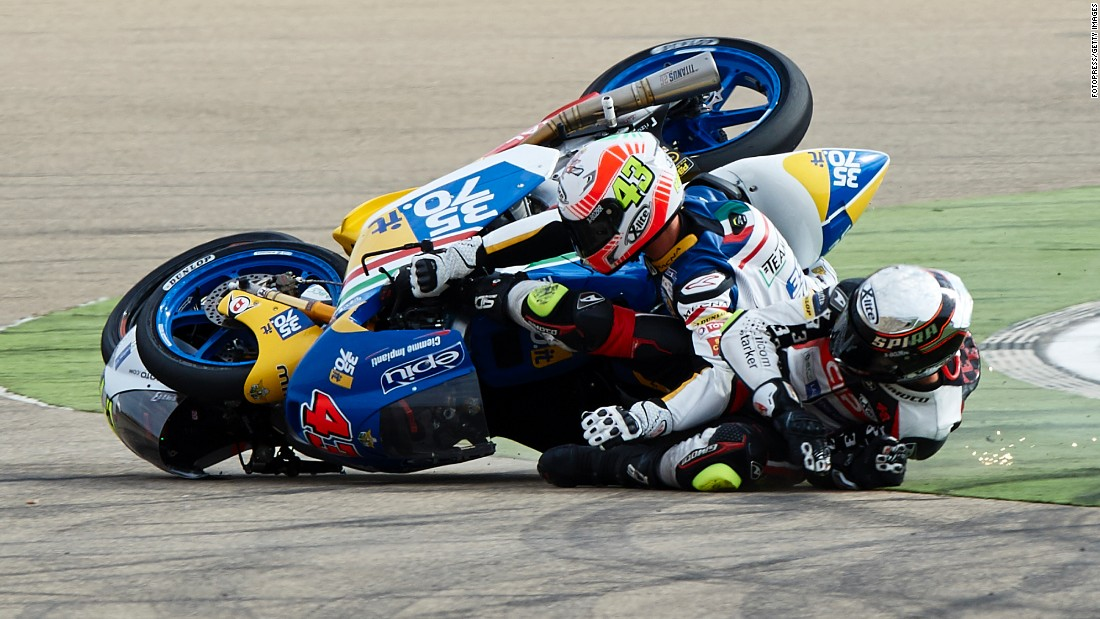 Stefano Valtulini, left, and Fabio Spiranelli crash into each other during a Moto3 race in Alcaniz, Spain, on Sunday, September 25.