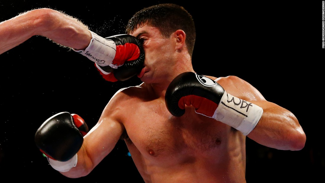 John Ryder takes a punch from Jack Arnfield during a middleweight bout in Manchester, England, on Saturday, September 24. Arnfield won a unanimous decision to get the WBA International title.