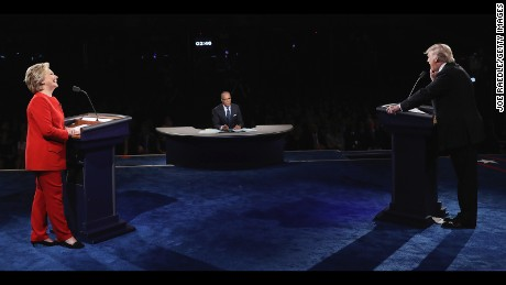 HEMPSTEAD, NY - SEPTEMBER 26:  Republican presidential nominee Donald Trump (R) speaks as Democratic presidential nominee Hillary Clinton (L) and Moderator Lester Holt (C) listen during the Presidential Debate at Hofstra University on September 26, 2016 in Hempstead, New York.  The first of four debates for the 2016 Election, three Presidential and one Vice Presidential, is moderated by NBC's Lester Holt.  (Photo by Joe Raedle/Getty Images)