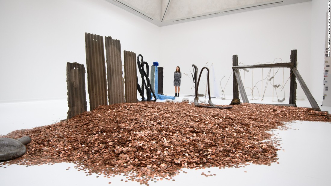 """""""Dean starts his process with writing, which he then gives physical form...using materials that are instantly recognisable from everyday life such as concrete, soil, sand, and corrugated sheet metal,"""" says the museum."""