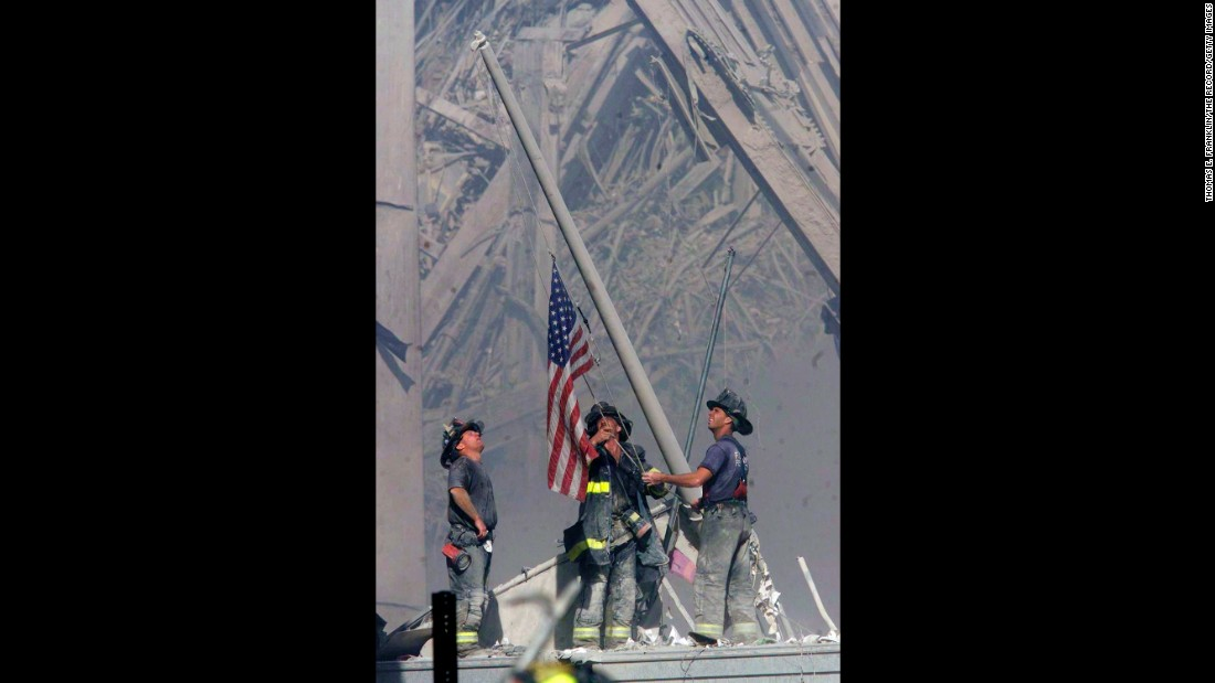 "Firefighters George Johnson, Dan McWilliams and Billy Eisengrein raise a flag at the site of the World Trade Center in New York after the terror attacks on September 11, 2001. The scene was immortalized by photographer Thomas E. Franklin and has been compared to the iconic image of the flag-raising at Iwo Jima. <a href=""http://www.cnn.com/SPECIALS/us/cnn-films-the-flag/index.html"">CNN Films' ""The Flag""</a> examines what happened to the flag at ground zero and explores its impact in the aftermath of the tragedy."