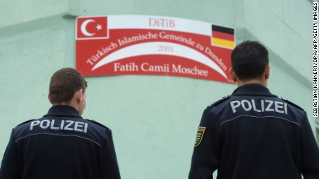 Two policemen stand in front of the Fatih Camii Mosque in Dresden, eastern Germany, on September 27, 2016, after a bomb attack. Bomb attacks hit a mosque and a congress centre in the eastern German city of Dresden, police said, addding that they suspected a xenophobic and nationalist motive. No-one was injured in the twin explosives attacks late Monday, September 26, 2016 in the city that has become a hotspot for far-right protests amid Germany's huge migrant influx. / AFP / dpa / Sebastian Kahnert / Germany OUT        (Photo credit should read SEBASTIAN KAHNERT/AFP/Getty Images)