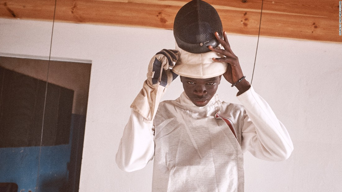 Daouda, 17 years old dresses in preparation for a fencing match. Child beggars and street children are also part of the classes and practice alongside incarcerated youths. More than 100 jailed minors have taken part in the program.<br />