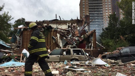 A firefighter at the scene of a New York building explosion that killed a battalion chief and injured 20 others on Tuesday.