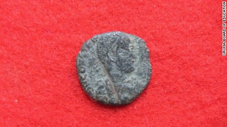 The front of a Roman coin.