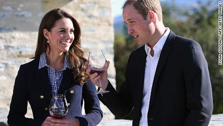 Britain's Prince William (R) and his wife Catherine, the Duchess of Cambridge (L), take part in a visit to the Amisfield Winery in Queenstown on April 13, 2014. Britain's Prince William, his wife Kate and their son Prince George are on a three-week tour of New Zealand and Australia. AFP PHOTO / POOL / Fiona Goodall (Photo credit should read Fiona GOODALL/AFP/Getty Images)