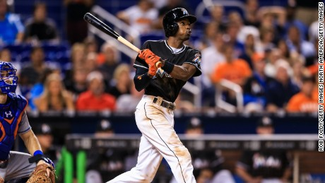 MIAMI, FL - SEPTEMBER 26: Dee Gordon of the Miami Marlins at bat during the game against the New York Mets at Marlins Park on September 26, 2016 in Miami, Florida. Dee, a left handed batter, hit his first career home run on the second pitch of the game. For the first pitch, he wore Jose Fernandez' batting helmet and stood in the right handed batter's box to honor the late pitcher.  (Photo by Rob Foldy/Getty Images)