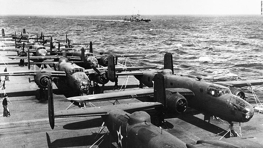 """As revenge for Japan's attack on Pearl Harbor, 80 US pilots, gunners, navigators and bombardiers led by Lt. Col. James """"Jimmy"""" Doolittle performed a daring one-way mission to bomb Japan in 1942. Half of the mission's 16 North American B-25 Mitchell bombers are seen here parked on the flight deck of the USS Hornet. Click through the gallery to see more images of the raid."""