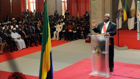 Gabon President elected Ali Bongo raises his hand during the swearing-in ceremony in Libreville.