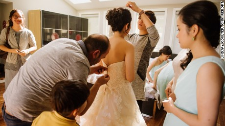 Ibrahim Halil Dudu, a neighbor and Syrian tailor, fixed Du's dress before the ceremony.