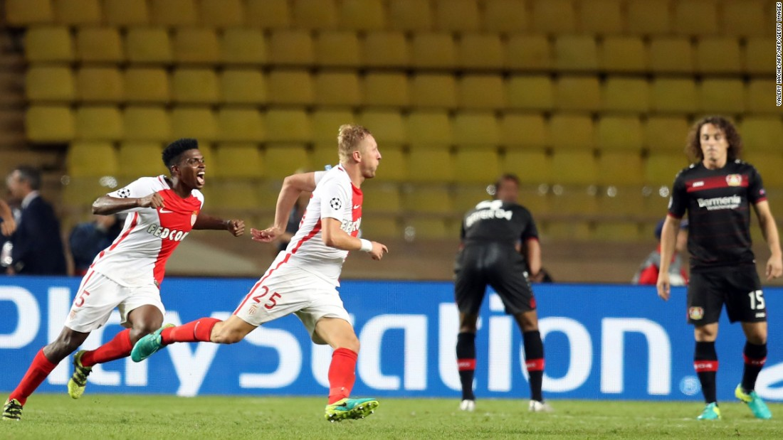 Kamil Glik celebrates after smashing home a late equaliser in  Monaco's Champions League game against Bayer Leverkusen, but only 8,100 fans attended the game.