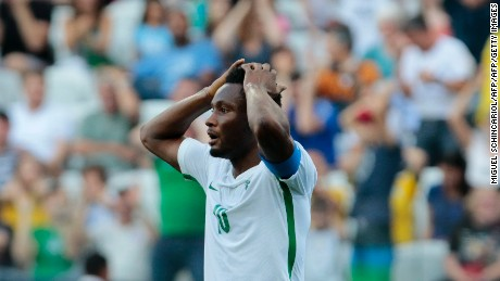 Nigeria's John Obi Mikel reacts during the Rio 2016 Olympic Games men's football semifinal match against Germany at the Corinthains Arena in Sao Paulo, Brazil, on August 17, 2016. / AFP / Miguel SCHINCARIOL        (Photo credit should read MIGUEL SCHINCARIOL/AFP/Getty Images)