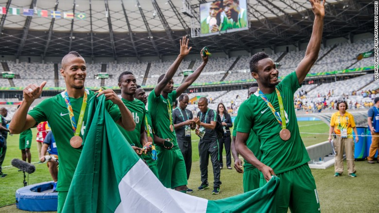 Happier times: Nigeria's players William Ekong (L) and John Obi Mikel (R) celebrate with bronze medals at the Rio 2016 Olympics. A Japanese fan gifted the cash-strapped team $390,000 after the match.