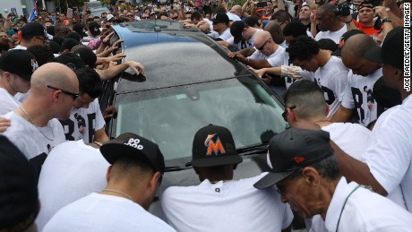 MIAMI, FL - SEPTEMBER 28: Miami Marlins players and members of the Marlins organization and their fans surround the hearse carrying Miami Marlins pitcher Jose Fernandez to pay their respects on September 28, 2016 in Miami, Florida.  Mr. Fernandez was killed in a weekend boat crash in Miami Beach along with two friends. (Photo by Joe Raedle/Getty Images)