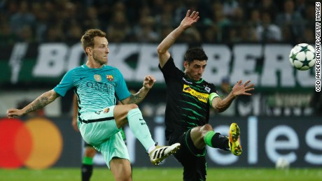 Barcelona's Croatian midfielder Ivan Rakitic (L) and Moenchengladbach's forward Lars Stindl vie for the ball during the UEFA Champions League first-leg group C football match between Borussia Moenchengladbach and FC Barcelona at the Borussia Park in Moenchengladbach, western Germany on September 28.