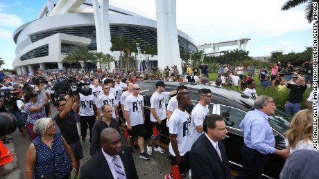 MIAMI, FL - SEPTEMBER 28:  Miami Marlins players and members of the Marlins organization and their fans walk next to the hearse carrying Miami Marlins pitcher Jose Fernandez to pay their respects as they pass in front of the Marlins baseball stadium on September 28, 2016 in Miami, Florida.  Mr. Fernandez was killed in a weekend boat crash in Miami Beach along with two friends.  (Photo by Joe Raedle/Getty Images)