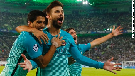 Barcelona's defender Gerard Pique celebrates scoring the 1-2 goal with his teammates during the UEFA Champions League first-leg group C football match between Borussia Moenchengladbach and FC Barcelona at the Borussia Park in Moenchengladbach, western Germany on September 28.