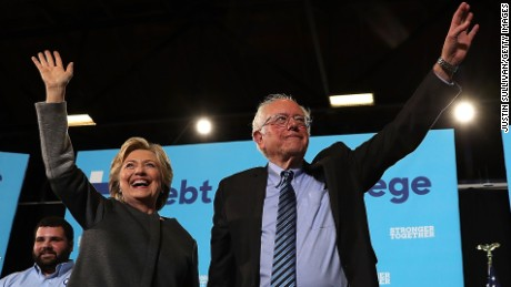 Democratic presidential nominee former Secretary of State Hillary Clinton (L) and U.S. Sen. Bernie Sanders (I-VT) greet supporters during a campaign rally at University of New Hampshire on September 28, 2016 in Durham, New Hampshire.