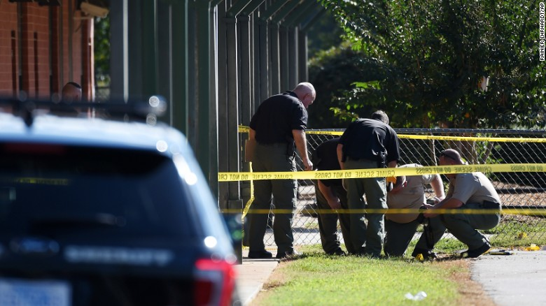The shooting started in the parking lot by the playground, police say.