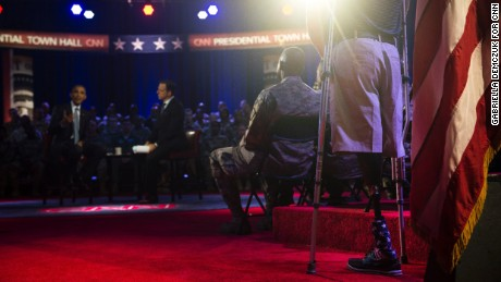 President Barack Obama at CNN's Town Hall in Fort Lee, Virginia, Wednesday, September 28. At right is Marine Corporal Brandon Rumbaugh. During his second deployment to Afghanistan, Rumbaugh lost both of his legs in an IED blast while carrying a stretcher to help his friends injured in an earlier explosion.