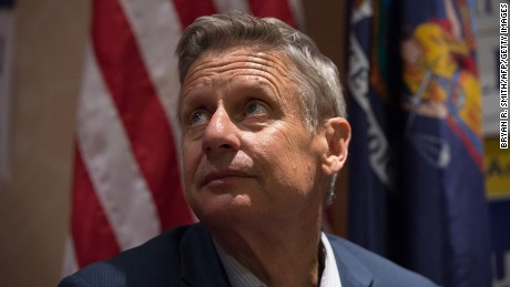 Libertarian presidential candidate Gary Johnson looks on as he speaks with the media at a rally on September 10, 2016 in New York. =