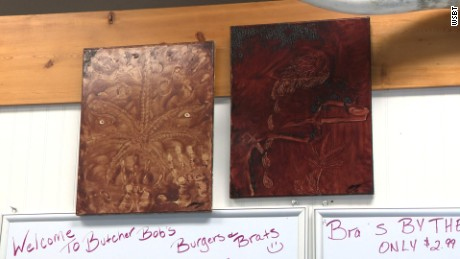 Indiana butcher Robert Long uses animal blood to paint canvases - he says he's sold some for $400.