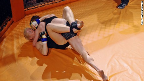 Malinda Diffee competes in the cage.