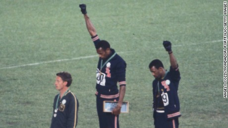 The American sprinters Tommie Smith,John Carlos and Peter Norman during the award ceremony of the 200 m race at the Mexican Olympic games. During the awards ceremony, Smith and Carlos protested against racial discrimination: they went barefoot on the podium and listened to their anthem bowing their heads and raising a fist with a black glove. Mexico City, Mexico, 1968 Mexico city, Mexico, 1968.