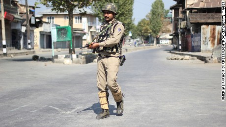 SRINAGAR, JAMMU AND KASHMIR, INDIA - 2016/09/28: An Indian trooper stand alert in old city, down town Srinagar amid restrictions in Indian controlled Kashmir. Tensions engulfed when a Hizb commander Burhan Wani was killed in an encounter with government forces. (Photo by Umer Asif/Pacific Press/LightRocket via Getty Images)