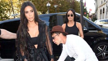 Photo by: KGC-195/STAR MAX/IPx 2016 9/28/16 Celebrity prankster Vitalii Sediuk strikes again - this time, grabbing Kim Kardashian outside L'Avenue Restaurant during Paris Fashion Week.  Sediuk has physically accosted a number of celebrities - gaining access to otherwise restricted areas with the use of press credentials from his former employer, Ukrainian Television TV Channel 1+1. (Paris, France)