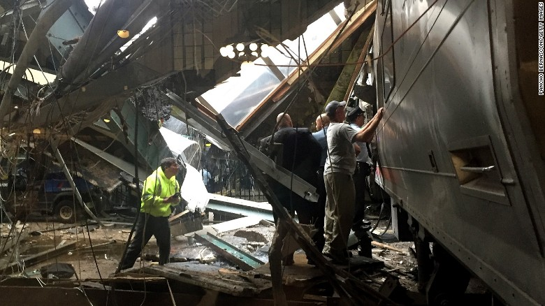 Emergency workers and others survey the train after the crash.