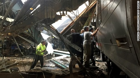 Train personel survey the NJ Transit train that crashed in to the platform at the Hoboken Terminal September 29, 2016 in Hoboken, New Jersey.