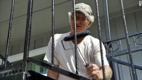Turning Point Center resident Richard, 63, helped paint railings in the courtyard.