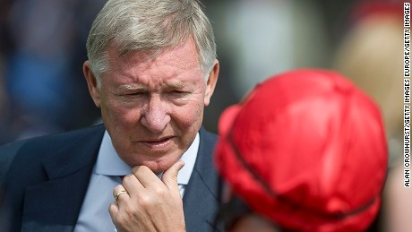 YORK, ENGLAND - AUGUST 17: Sir Alex Ferguson chats with jockey Michael Hills at York racecourse on August 17, 2011 in York, England. (Photo by Alan Crowhurst/ Getty Images)