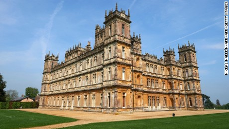 """Highclere Castle, is pictured in Highclere, southern England, on May 12, 2016.As Britain mulls questions of identity and its possible exit from the European Union, 2016 is an anniversary year for three of its most potent symbols: the queen, Shakespeare and gardener """"Capability"""" Brown. Lancelot """"Capability"""" Brown is credited with having created over 170 gardens, among them the grounds of Highclere Castle, made famous as the set of the hit television series Downton Abbey. / AFP / NIKLAS HALLE'N / TO GO WITH AFP STORY BY FLORENCE BIEDERMANN        (Photo credit should read NIKLAS HALLE'N/AFP/Getty Images)"""