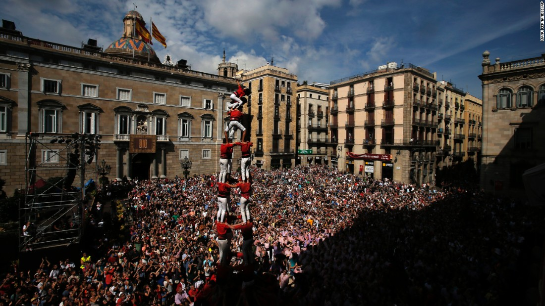 "Members of the Castellers form a human tower or ""castel"" during the La Merce celebrations in Barcelona, Spain, on Sunday, September 25."