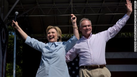 Democratic presidential nominee Hillary Clinton (L) and her running mate Tim Kaine cheer during a Labor Day rally September 5, 2016 in Cleveland, Ohio.